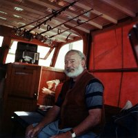 American Author Ernest Hemingway aboard his Yacht around 1950 - Wikimedia commons JPEG